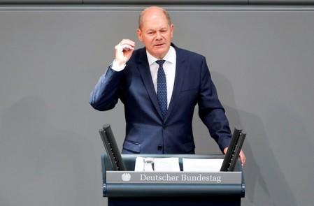 German Finance Minister Olaf Scholz addresses lower house of parliament (Bundestag) during a budget session in Berlin