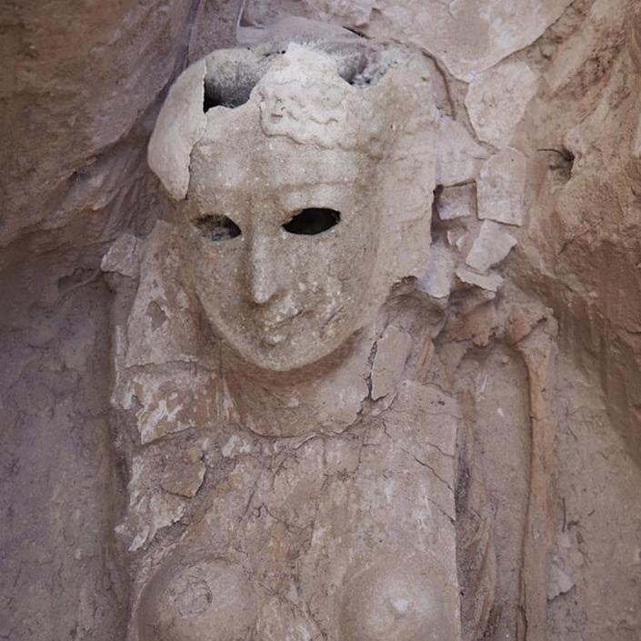 A burial mask showing the face of a woman with holes for the eyes - MINISTRY OF TOURISM AND ANTIQUTIES HANDOUT/EPA-EFE/Shutterstock