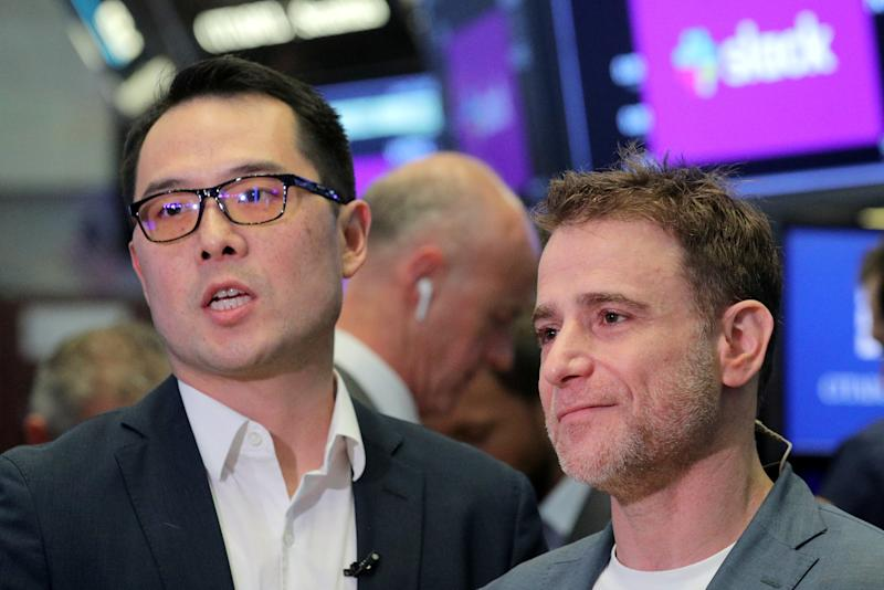 Slack Technologies Inc. CEO Stewart Butterfield (R) stands with CFO Allen Shim on the trading floor during the company's IPO at the New York Stock Exchange (NYSE) in New York, U.S. June 20, 2019. REUTERS/Brendan McDermid