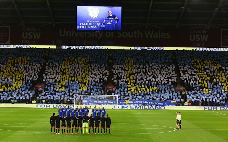 Cardiff City and Bournemouth players and supporters observe a minute's reflection in honour of Emiliano Sala - AFP