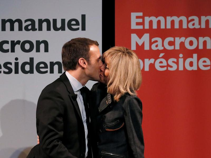 Emmanuel Macron kisses his wife Brigitte at a campaign rally