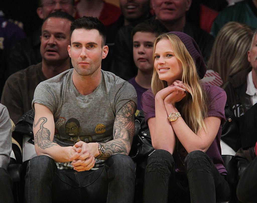"Maroon 5 frontman Adam Levine, with model girlfriend Anne Vyalitsyna, was philosophical about his team's defeat, tweeting after the game, ""I'm gonna think of today's laker loss as a welcome loss for a team fixated on beating the heat on Xmas day…"" Noel Vasquez/<a href=""http://www.gettyimages.com/"" target=""new"">GettyImages.com</a> - December 21, 2010"