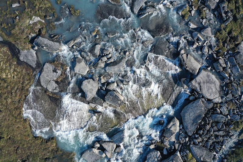 In this aerial view water from the Greenland ice sheet rushes down at what a local guide said is an unprecedentedly high level in the last 19 years during unseasonably warm weather at Eqip Sermia, Greenland. (Photo: Sean Gallup/Getty Images)