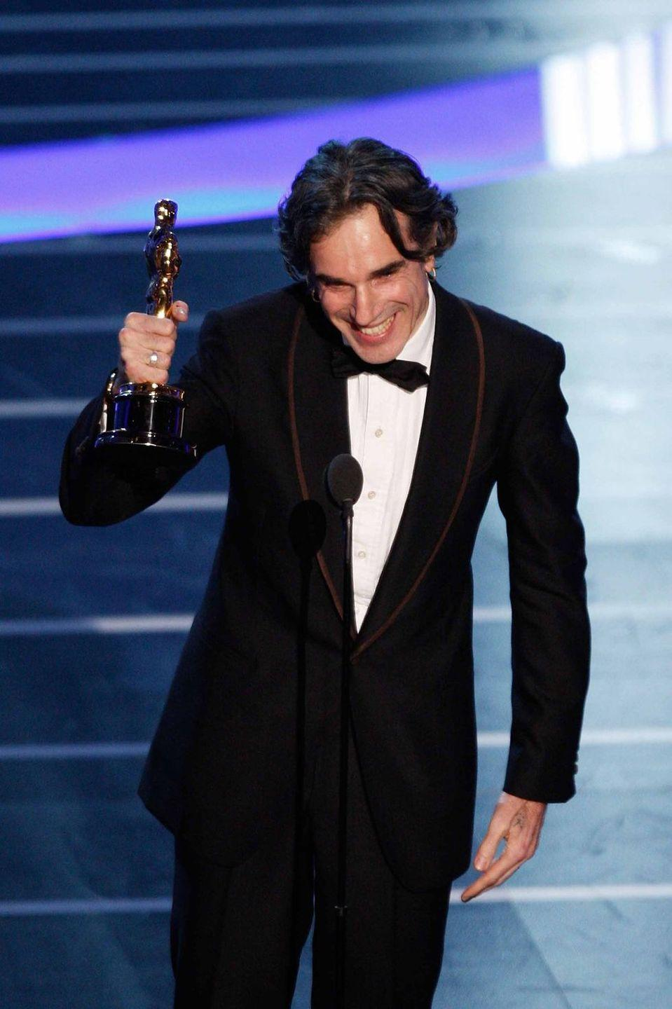 <p>As much of a chameleon on the carpet as in his films, every iteration of Daniel Day-Lewis's award-show style is impressive.</p>