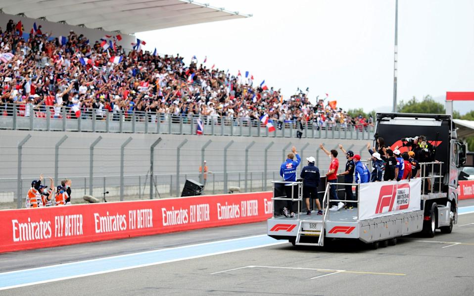 The F1 drivers wave to fans from the back of a truck to show their appreciation to the fans around the circuit prior to the F1 Grand Prix of France at Circuit Paul Ricard on June 20, 2021 in Le Castellet, France - Peter Fox/Getty Images