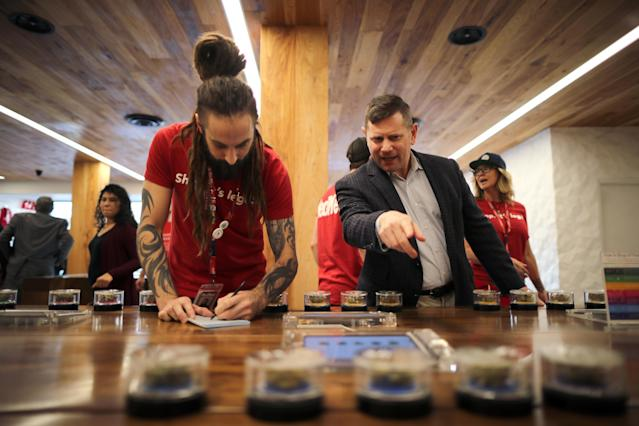 <p>Eron Silverstein, 51, (R) shops for marijuana at the MedMen store in West Hollywood, Calif., Jan. 2, 2018. (Photo: Lucy Nicholson/Reuters) </p>