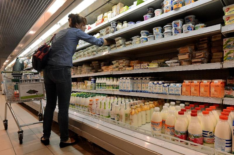 File photo shows a woman looking at dairy products in a supermarket in central Moscow on August 5, 2013