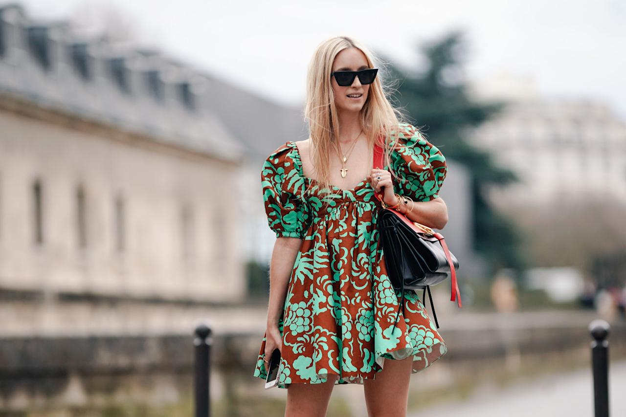 """<p>One of my favorite<a href=""""https://www.marieclaire.com/spring-fashion-guide/"""" target=""""_blank""""> trends of 2020: </a>Statement, voluminous baby doll dresses, a dreamy combination of chic and effortless. Slipping on a baby doll dress instantly gives you a relaxed vibe, thanks to the outfit's voluminous silhouette, puffed sleeves, and/or tiered skirts. With this spring/summer trend, ease is key, and honestly—that's music to my ears. Designers like Molly Goddard, Simone Rocha and Cecilie Banhsen have been sending these kind of dresses, a mix of femininity and billowing silhouettes, down the runway season after season. Now, editors and influencers galore are hitting the sidewalks of the city to put their own twist on this spring trend. Here's how to make it work for you.<br></p>"""