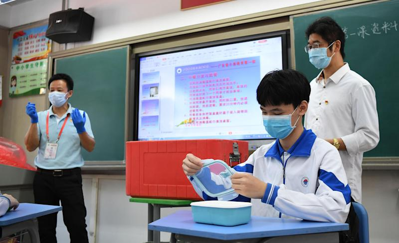 GUANGZHOU, April 27, 2020 -- A student demonstrates dining precautions in class at Guangzhou Huadi Middle School in Liwan District of Guangzhou, south China's Guangdong Province, April 27, 2020. Students in graduating classes of Guangzhou's junior and senior high schools returned to school on Monday as the novel coronavirus epidemic continued to ebb away across the country. (Photo by Deng Hua/Xinhua via Getty) (Xinhua/Deng Hua via Getty Images)