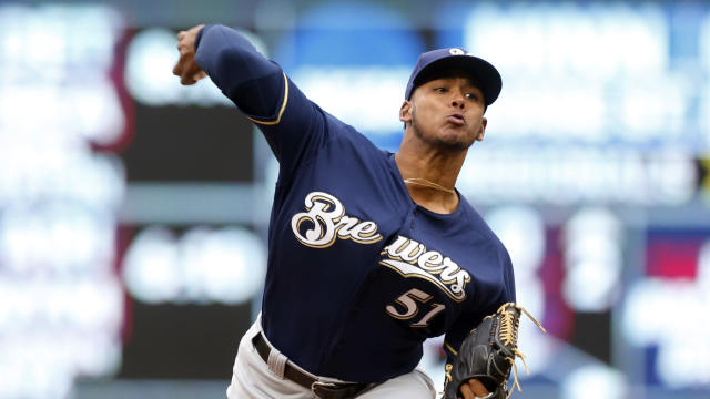 "<a class=""link rapid-noclick-resp"" href=""/mlb/players/11014/"" data-ylk=""slk:Freddy Peralta"">Freddy Peralta</a> should be back in The Show next week (AP Photo/Jim Mone)"
