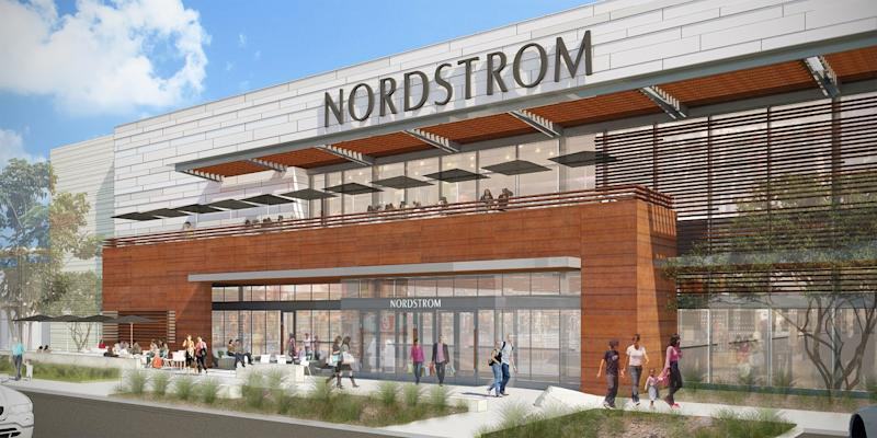 Outside front of Nordstrom store, with dozens of people outside and a second-floor cafe above the entrance.