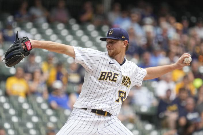 Milwaukee Brewers starting pitcher Eric Lauer throws during the first inning of a baseball game against the Colorado Rockies Sunday, June 27, 2021, in Milwaukee. (AP Photo/Morry Gash)