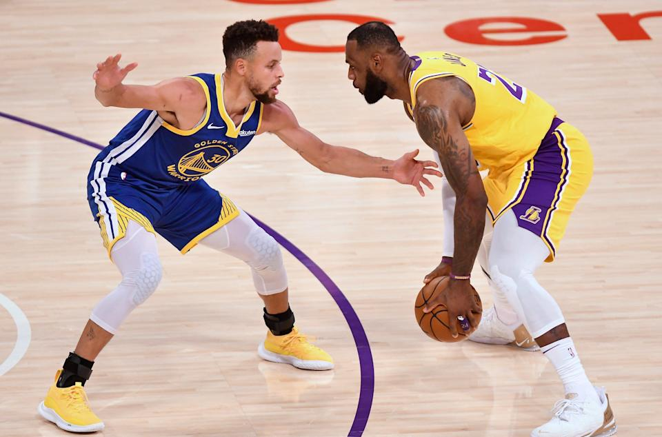 LeBron James goes up against Steph Curry during a game at Staples Center on Jan. 18. The two will meet in an NBA playoff play-in game Wednesday.