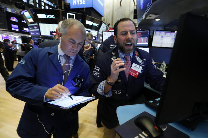 Trader Timothy Nick, left, and specialist Michael Pistillo work on the floor of the New York Stock Exchange, Monday, March 9, 2020. The Dow Jones Industrial Average plummeted 1,500 points, or 6%, following similar drops in Europe after a fight among major crude-producing countries jolted investors already on edge about the widening fallout from the outbreak of the new coronavirus. (AP Photo/Richard Drew)