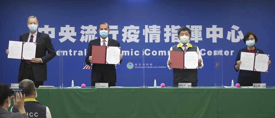 From left; Director of the American Institute in Taiwan (AIT) William Brent Christensen, U.S. Health and Human Services Secretary Alex Azar, Taiwanese Minister of Health and Welfare Chen Shih-chung and Director-General of Bureau of Foreign Trade Yang Jen-ni pose for a photo during a memorandum of understanding signing ceremony at the Central Epidemic Command Center in Taipei, Taiwan, Monday, Aug. 10, 2020. Azar arrived in Taiwan on Sunday in the highest-level visit by an American Cabinet official since the break in formal diplomatic relations between Washington and Taipei in 1979. (AP Photo/Chiang Ying-ying)