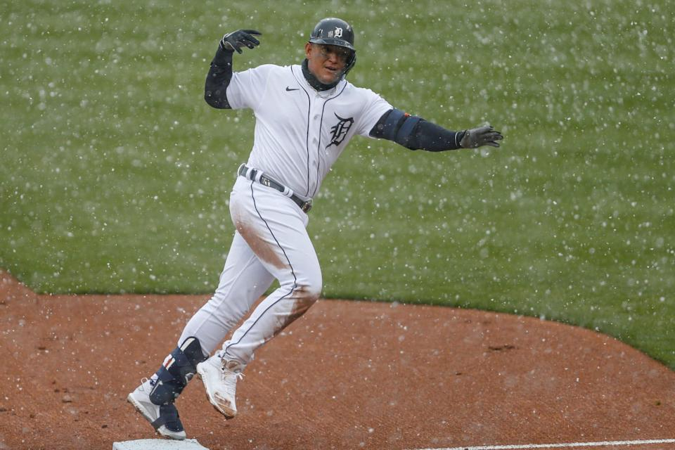 Detroit Tigers first baseman Miguel Cabrera celebrates as he rounds the bases in the snow after hitting a two-run home run during the first inning against the Cleveland Indians on Opening Day at Comerica Park on April 1, 2021.