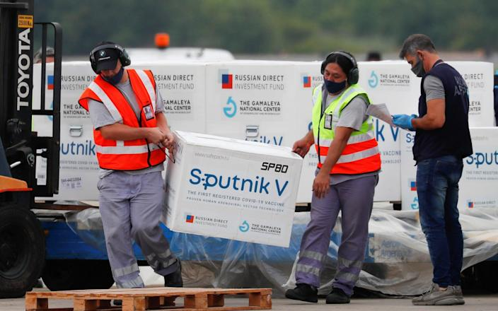 A shipment of doses of the Sputnik V (Gam-COVID-Vac) vaccine against the coronavirus disease (COVID-19) is transported after arriving at the Ezeiza International Airport, in Buenos Aires, Argentina - AGUSTIN MARCARIAN/REUTERS