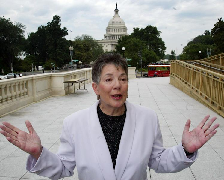 """FILE - This June 11, 2003 file photo shows Martha Burk, of the National Council of Women's Organizations, gesturing during a news conference on Capitol Hill in Washington. For the first time in its 80-year history, Augusta National Golf Club has female members. """"This is a joyous occasion,"""" Augusta National chairman Billy Payne said Monday, Aug. 20, 2012. The move likely ends a debate that intensified in 2002 when Burk urged the club to include women among its members. (AP Photo/Rick Bowmer, File)"""