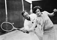 <p>Joan Crawford appears to be a natural as she receives instruction from tennis champion Harvy Snodgrass, circa 1930. </p>