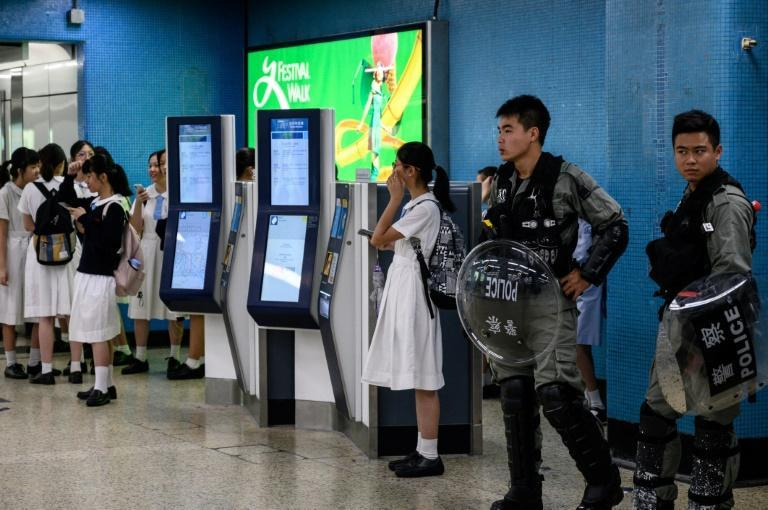 Riot police patrolled some subway stations after protesters disrupted rush hour services (AFP Photo/Philip FONG)