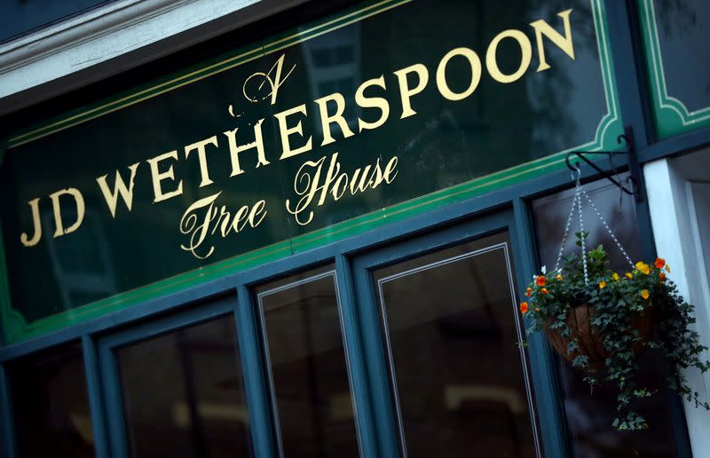 FILE PHOTO: FILE PHOTO: A Wetherspoon's logo is seen at a pub in central London