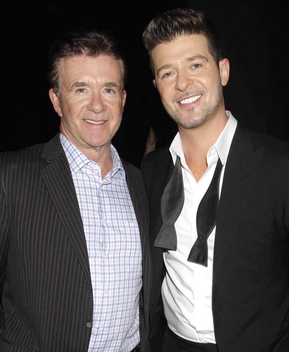 """<p>""""After my father's death, I remember a friend of his said, 'A big tree has fallen.' That's what my dad was: the big tree,"""" <a href=""""https://people.com/music/robin-thicke-wants-to-be-as-much-like-late-father-alan-as-possible/"""" rel=""""nofollow noopener"""" target=""""_blank"""" data-ylk=""""slk:Robin told PEOPLE"""" class=""""link rapid-noclick-resp"""">Robin told PEOPLE</a>. """"Now here I am, this medium-size tree, and I've got to grow my branches and protect everybody. Every day I try to make him proud of me.</p> <p>""""Every time I speak to my son Julian, I feel him because I'm saying the same things he told me,"""" he continued. """"When I was young, I wanted to be a rebel because my dad was Mr. Good Guy. Now I just want to be as much like him as possible. In the end, all the advice he gave me was correct.""""</p>"""