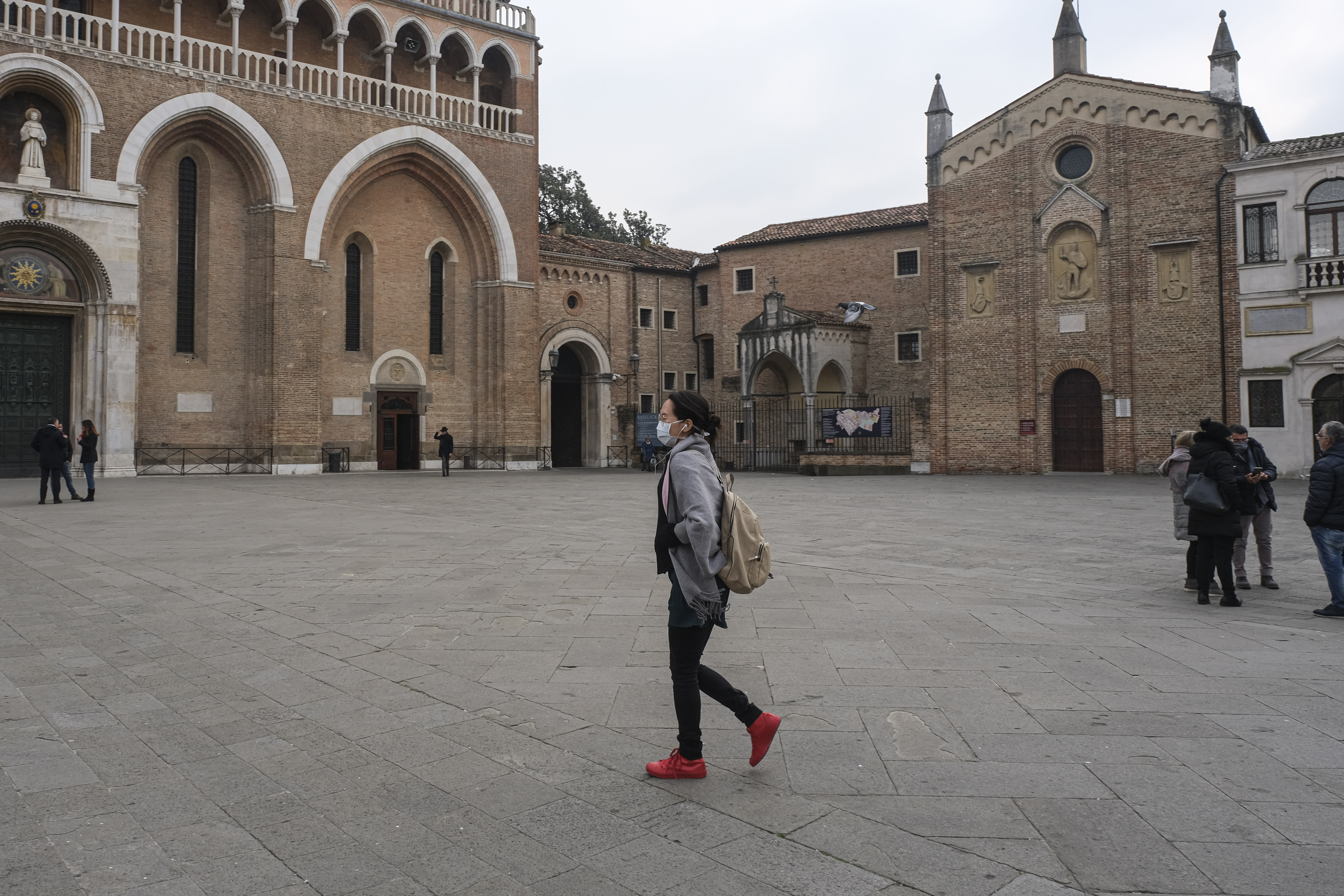 A group of Chinese tourists in Piazza del Santo wears protective masks in Padua, Italy, on February 24, 2020. More than 220 people were infected by Covid-19 in Italy, with 6 people deaths. Italy is at the third place in the world ranking as infected countries, after China e South Korea. Italy has disposed the closure of schools, university, pubs and imposed a stop to religious functions in Lombardia and Veneto regions. (Photo by Roberto Silvino/NurPhoto via Getty Images)