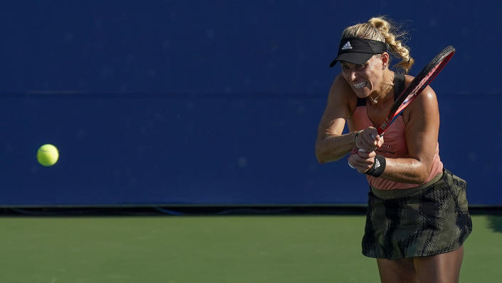 Angelique Kerber, of Germany, returns a shot to Dayana Yastremska, of the Ukraine, during the first round of the US Open tennis championships, Monday, Aug. 30, 2021, in New York. (AP Photo/Seth Wenig)