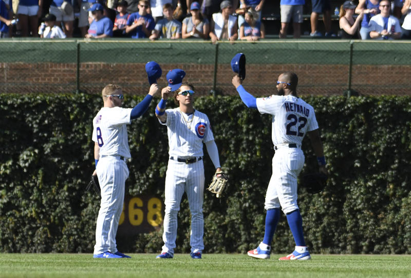 Chicago Cubs left fielder Ian Happ (8) center fielder Albert Almora Jr, center, and right fielder Jason Heyward (22) celebrate their 6-2 win against the Milwaukee Brewers in a baseball game, Friday, Aug. 2, 2019, in Chicago. (AP Photo/David Banks)