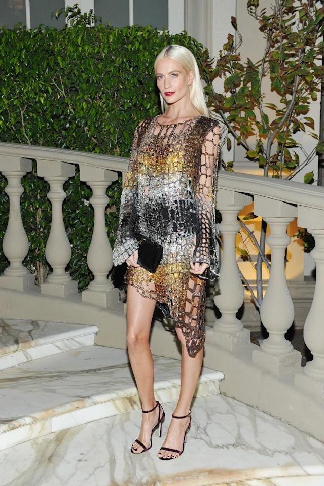<p>Delevingne stunned in this netted metalic look. (Photo by Donato Sardella/Getty Images for BALMAIN) </p>