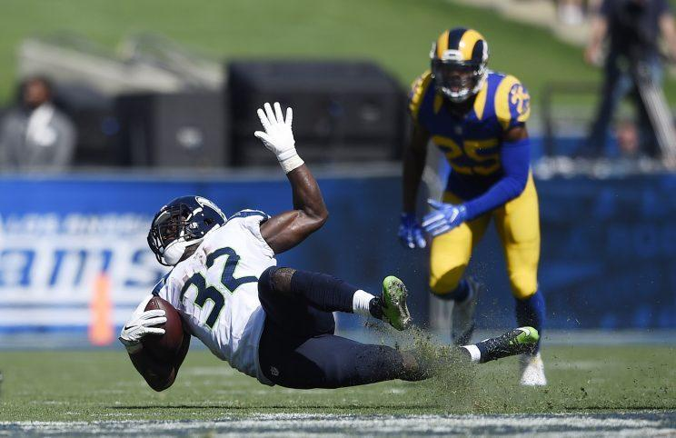 Christine Michael of the Seahawks slips up during Sunday's loss (AP)