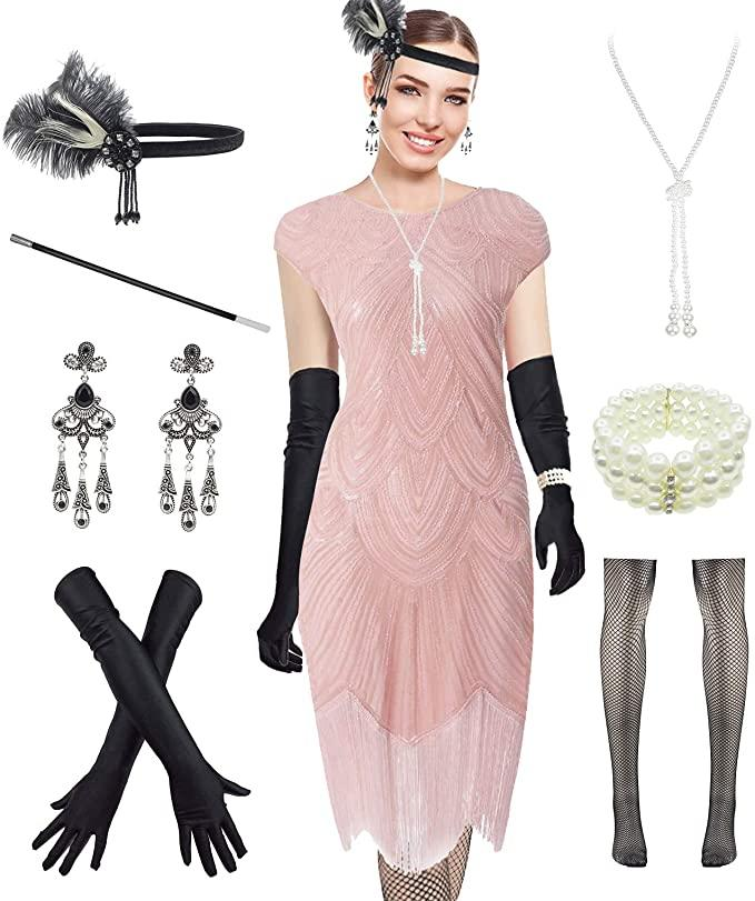 Woman wears 190s Vintage Flapper Set with beaded pink dress, black gloves, headband and jewelry