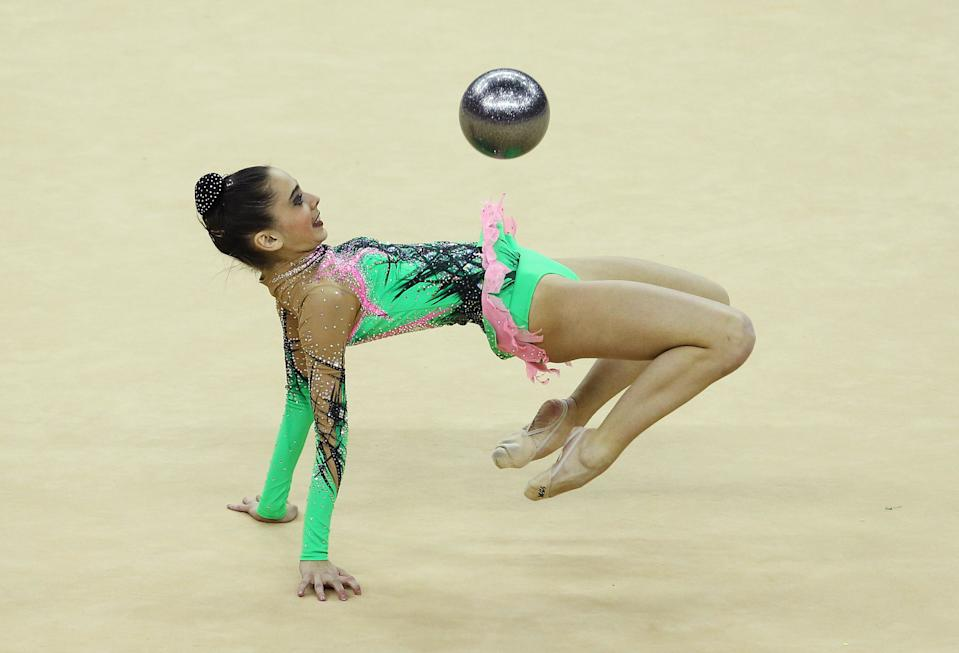 Anna Czarniecka of Poland in action in the Individual All-Around during the FIG Rhythmic Gymnastics Olympic Qualification round at North Greenwich Arena in London.