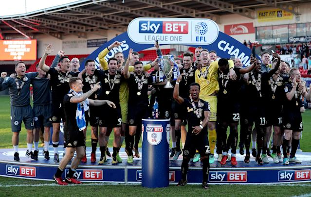 "Soccer Football - League One - Doncaster Rovers vs Wigan Athletic - Keepmoat Stadium, Doncaster, Britain - May 5, 2018 Wigan Athletic celebrate with the trophy after winning League One Action Images/John Clifton EDITORIAL USE ONLY. No use with unauthorized audio, video, data, fixture lists, club/league logos or ""live"" services. Online in-match use limited to 75 images, no video emulation. No use in betting, games or single club/league/player publications. Please contact your account representative for further details."
