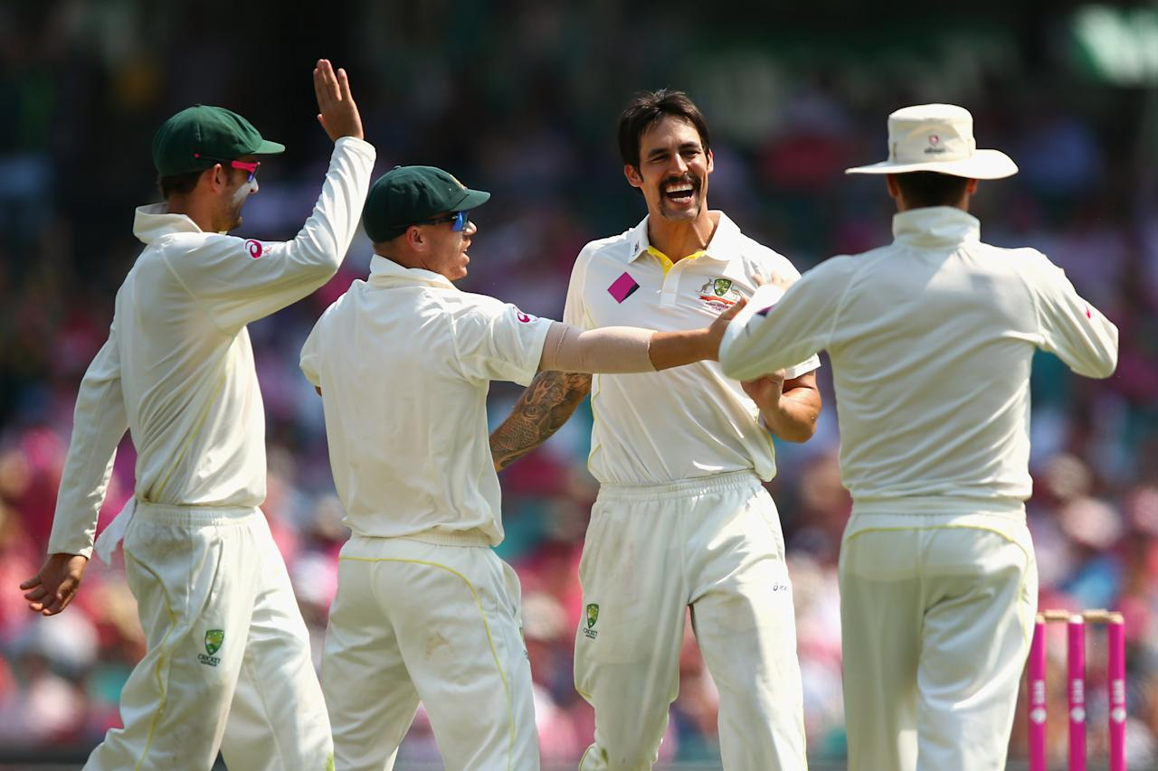 SYDNEY, AUSTRALIA - JANUARY 05:  Mitchell Johnson of Australia celebrates dismissing Michael Carberry of England during day three of the Fifth Ashes Test match between Australia and England at Sydney Cricket Ground on January 5, 2014 in Sydney, Australia.  (Photo by Cameron Spencer/Getty Images)