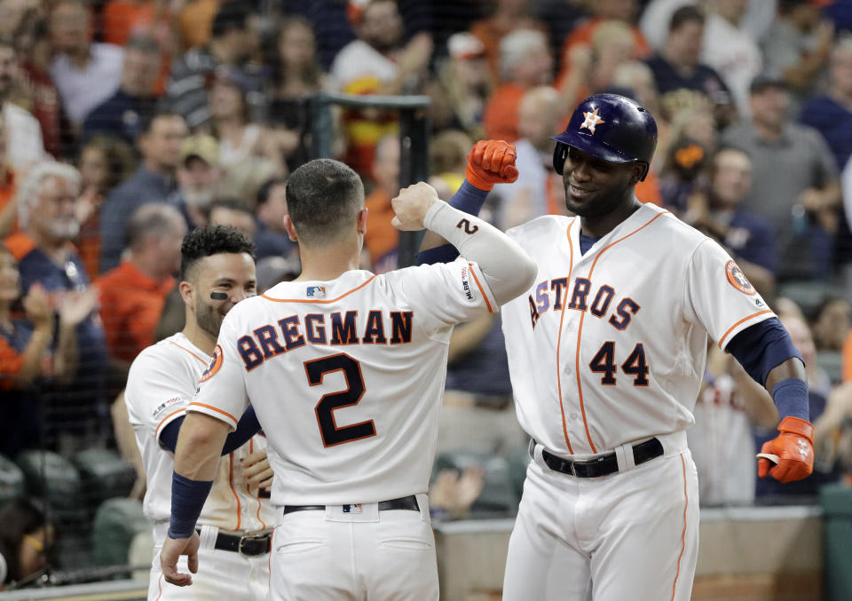 Houston Astros' Yordan Alvarez (44) celebrates with Alex Bregman (2) after hitting a home run against the Oakland Athletics during the second inning of a baseball game Monday, Sept. 9, 2019, in Houston. (AP Photo/David J. Phillip)