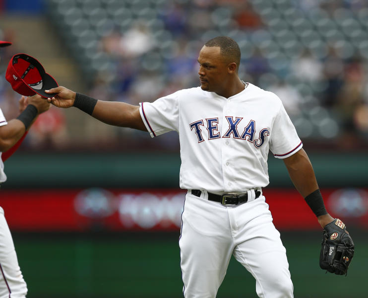 Texas Rangers' Adrian Beltre tips his hat to the Seattle Mariners bench after being relieved of his duties at third base during the sixth inning of a baseball game, Sunday, Sept. 23, 2018, in Arlington, Texas. (AP Photo/Jim Cowsert)
