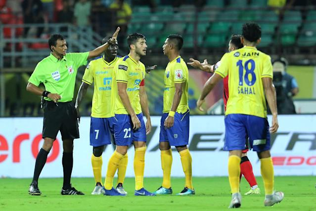 Kerala Blasters FC players argue with the Referee