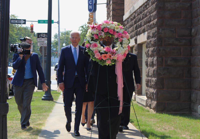 "Former Vice President and presidential candidate Joe Biden, center left, joins Sen. Doug Jones and Birmingham Mayor Randall Woodfin at a wreath laying after a service at 16th Street Baptist Church in Birmingham, Ala., Sunday, Sept. 15, 2019. Visiting the black church bombed by the Ku Klux Klan in the civil rights era, Democratic presidential candidate Biden said Sunday the country hasn't ""relegated racism and white supremacy to the pages of history"" as he framed current tensions in the context of the movement's historic struggle for equality. (Ivana Hrynkiw/The Birmingham News via AP)"
