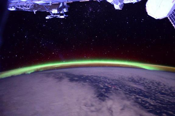 Green auroras dance over Earth in this photo by NASA astronaut Terry Virts captured on June 10, his last full day in space before landing on a Soyuz spacecraft on June 11, 2015.