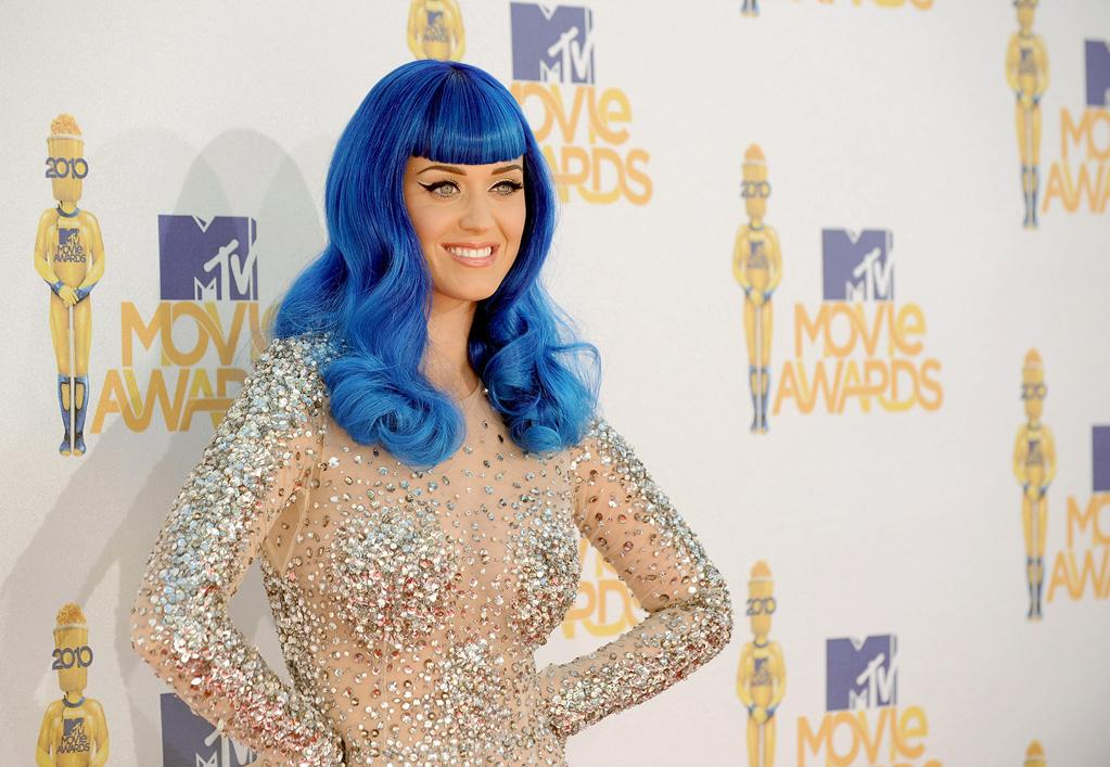 "Sporting a blue wig on the MTV red carpet in homage to her upcoming Smurfs character, Katy Perry tweeted a message seemingly aimed at Lady Gaga's new, religious-themed video for ""Alejandro"" Tuesday. The daughter of two ministers posted, ""Using blasphemy as entertainment is as cheap as a comedian telling a fart joke."" Ball's in your court, Gaga. Jason Merritt/<a href=""http://www.gettyimages.com/"" target=""new"">GettyImages.com</a> - June 6, 2010"