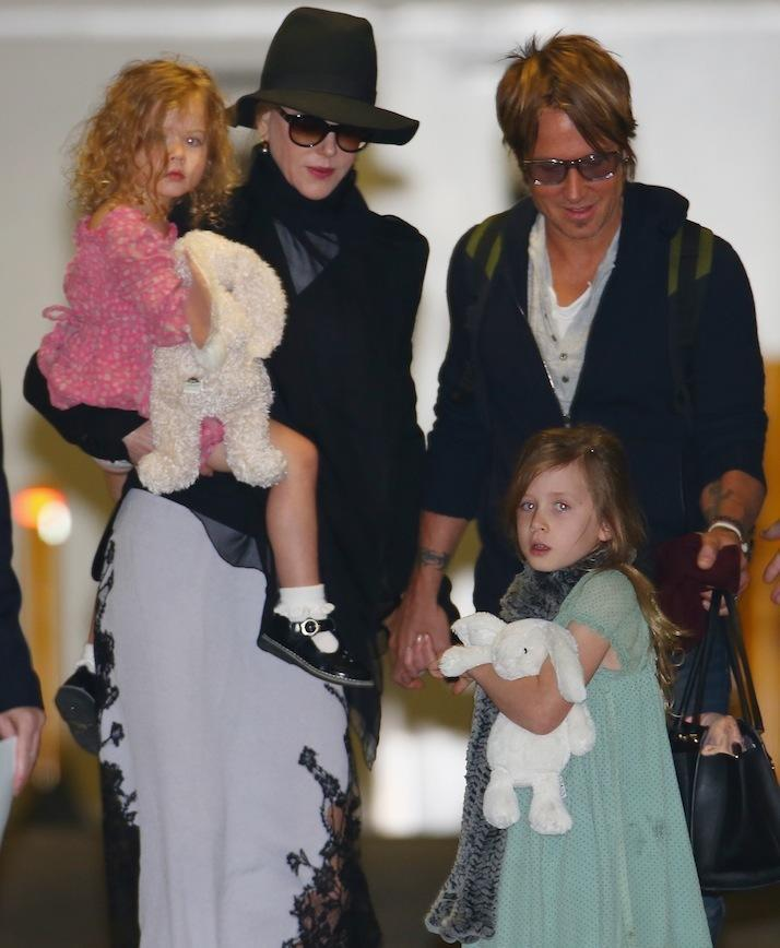 Nicole and Keith arriving in Sydney with their two daughters last year