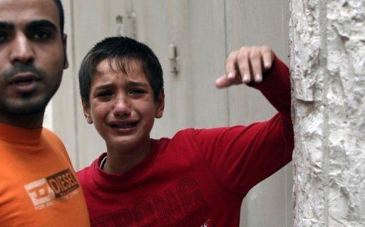 A Palestinian youth cries after his relative was killed in a blast at the Naama building in Gaza city. There was a second Israeli strike on the building which houses AFP's offices, according to Hamas health officials