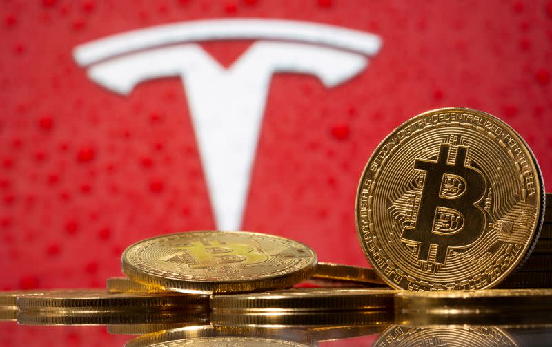 FILE PHOTO: FILE PHOTO: Representations of virtual currency Bitcoin are seen in front of Tesla logo in this illustration