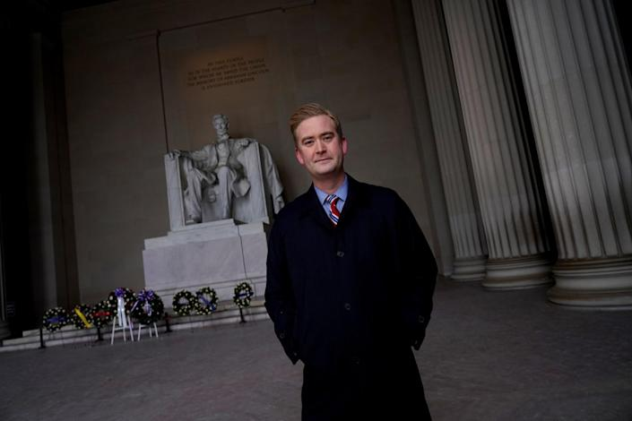 Peter Doocy stands in front of the Lincoln Memorial.