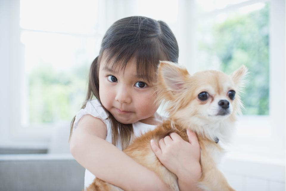 Previous studies have shown children often turn to pets for comfort and to voice their concerns. (Posed by a model, Getty Images)