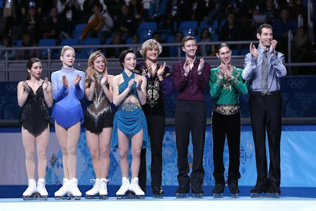 SOCHI, RUSSIA - FEBRUARY 09: Bronze medalists the United States figure skating team (L-R) Maria Castelli, Gracie Gold, Ashley Wagner, Meryl Davis, Charlie White, Jeremy Abbott, Jason Brown and Simon Shnapir celebrate during the flower ceremony for the competes in the Team Ladies Free Skating during day two of the Sochi 2014 Winter Olympics at Iceberg Skating Palace onon February 9, 2014 in Sochi, Russia. (Photo by Matthew Stockman/Getty Images)