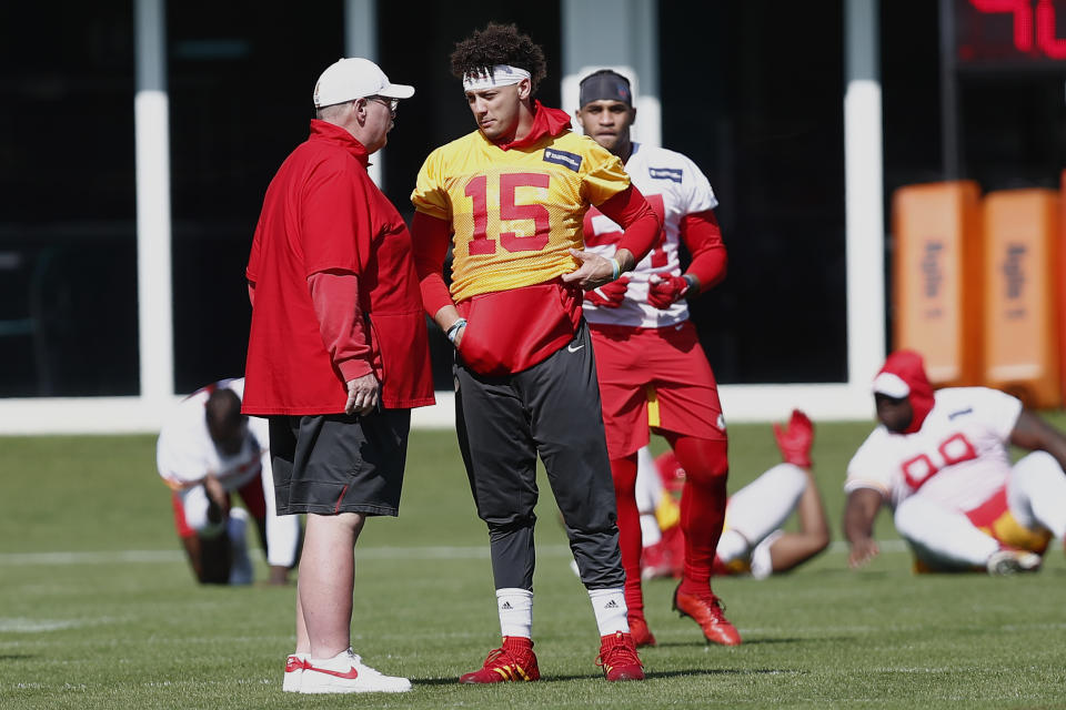 Kansas City Chiefs quarterback Patrick Mahomes (15) talks with head coach Andy Reid during practice on Wednesday. (AP Photo/Brynn Anderson)