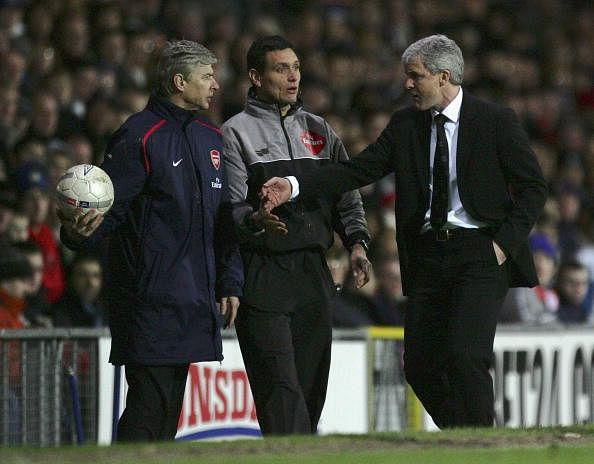 Mark hughes and Arsene Wenger are old foes