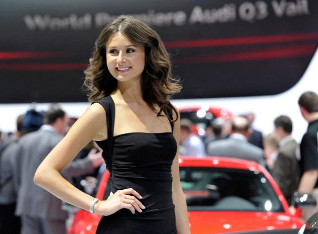 A model stands near the Audi display on the first press preview day for the North American International Auto Show in Detroit, Michigan, January 9, 2012. REUTERS/Mike Cassese